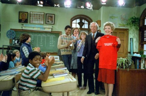 "3/9/1983 Nancy Reagan holds a t-shirt during rehearsal and Taping of television show ""Different Strokes"" with Conrad Bain Gary Coleman Todd Bridges Dana Plato and Mary Jo Cattlett at Universal Studios in Los Angeles California"