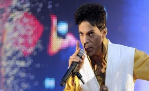 US singer and musician Prince (born Prince Rogers Nelson) performs on stage at the Stade de France in Saint-Denis, outside Paris, on June 30, 2011. AFP PHOTO BERTRAND GUAY